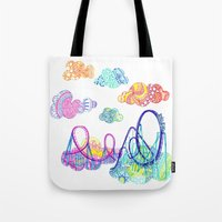 coasters Tote Bags featuring We'll see you in style, riding rainbow roller-coasters in the sky. by Jenny Robins