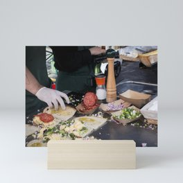 Preparing salami sandwiches Mini Art Print