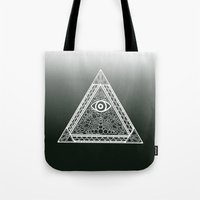 evil eye Tote Bags featuring Evil Eye by Emmy