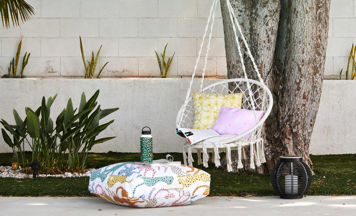 backyard setup with outdoor floor cushion, water bottle and more