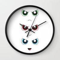 powerpuff girls Wall Clocks featuring The Powerpuff Girls by M. C.Tees