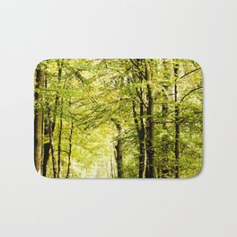 A pathway covered by leaves in a magical forest Bath Mat