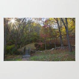 Small bridge & lake in Autumn Rug
