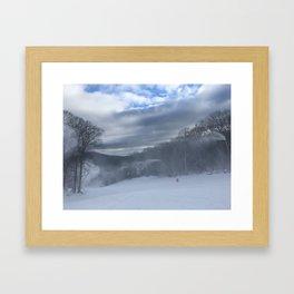 Making snow Framed Art Print