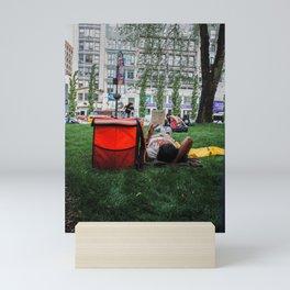People Laying in the Street Garden Mini Art Print