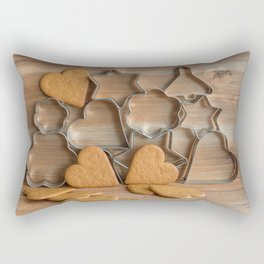Heart shaped ginger cookies and metal cookie cutters on rustic wood Rectangular Pillow