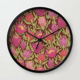 Pink protea flowers with green leaves on brown background Wall Clock