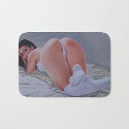 White Socks and a Peach Bath Mat