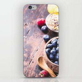 Close-up of fresh fruits and seeds in wooden tray iPhone Skin
