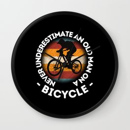 Never Underestimate An Old Man On A Bicycle Wall Clock