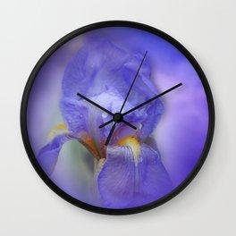 Iris and blue sky Wall Clock