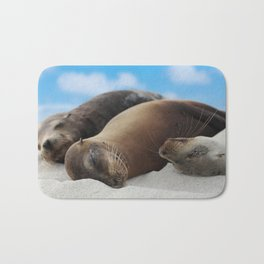 Galapagos Sea lions family sleeping on beach Bath Mat