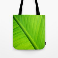 banana leaf Tote Bags featuring Upclose Banana Leaf by Erin Mac Photography