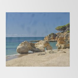 rock formation on Olhos d'Agua beach, Portugal Throw Blanket
