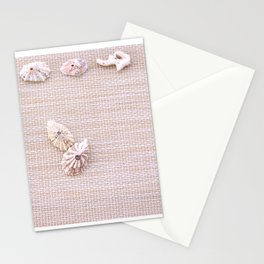 Urchins and seashells nautical design on textured background. Stationery Cards
