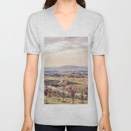 countryside view with sunset sky and green field with mountain view Unisex V-Neck