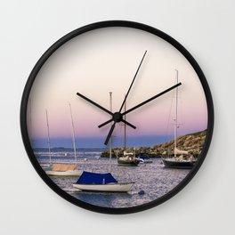 Earth's shadow over the harbor Wall Clock