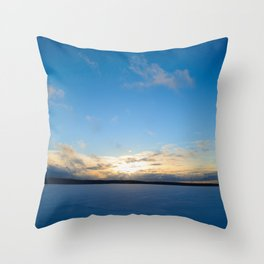 Sunset  on  blue sky over a snowy frozen lake winter on  the horizon over the ice Throw Pillow