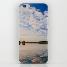 Cloudy Sky Reflecting In the Water at Sunset iPhone & iPod Skin