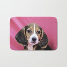 Closeup of a Tricolor Beagle Puppy on a Pink Background Bath Mat