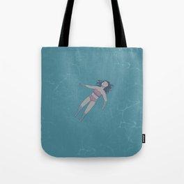 Girl Floating in the Ocean Tote Bag