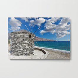 A windmill on the beach of Korthi in Andros island, Greece Metal Print