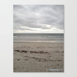 Cloudy Waters on the Sand Canvas Print