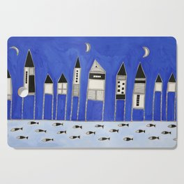 Tiny houses and fish in blue Cutting Board