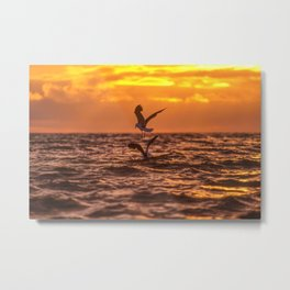 Seagulls flying over the sea in sunset Metal Print
