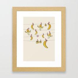 Bananas on clothespins Framed Art Print
