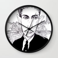 kafka Wall Clocks featuring Franz Kafka by Howard Coale