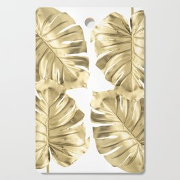 Gold Monstera Leaves on White Cutting Board