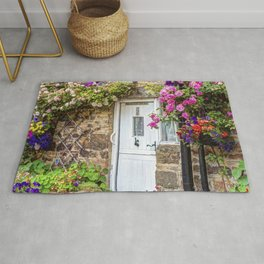 Colorful country house with flowers Rug