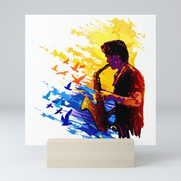 Colorful music player with flying birds.Musician portrait, saxophonist performance Mini Art Print