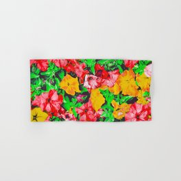 closeup flower abstract background in pink red yellow with green leaves Hand & Bath Towel