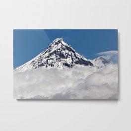 Stunning snowy top of rocky volcanoes cones above clouds. Beautiful mountain landscape of Kamchatka Metal Print