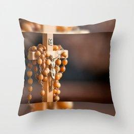 Jesus figurine and rosary Throw Pillow