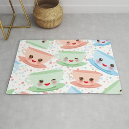 Cute blue pink green Kawai cup, coffee tea with pink cheeks and winking eyes, polka dot background Rug