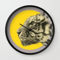 eric fan Wall Clocks featuring Wild 4 by Eric Fan & Garima Dhawan by Garima Dhawan