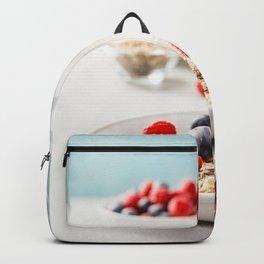 Oatmeal porridge with fresh berries and almond milk Backpack