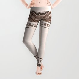 Decorative brown stripes on a beige background. Leggings