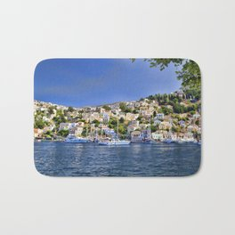 Symi island in Greece. Traditional houses. Sunny day with blue sky and sea. Bath Mat