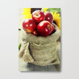 Burlap sack with apples on a wooden table Metal Print