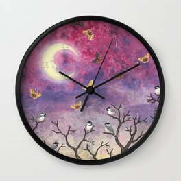 chickadees and io moths in the moonlit sky Wall Clock