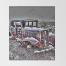 Rusting in the desert Throw Blanket