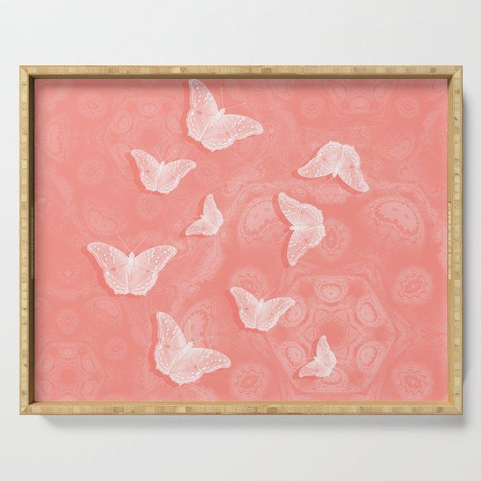 A flutter of butterflies on peach mandala patterns Serving Tray