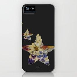 Pressed flower star pattern on black background iPhone Case