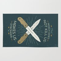 nietzsche Area & Throw Rugs featuring That which does not kill us makes us stronger by Beardy Graphics