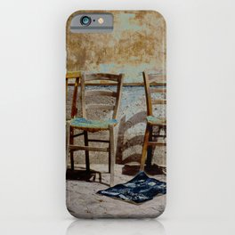 Three chairs and newspaper iPhone Case