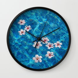Almond blossom floating in swimming pool Wall Clock